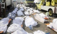 ATTENTION EDITORS - VISUAL COVERAGE OF SCENES OF DEATHBodies of Muslim pilgrims are seen after a stampede at Mina, outside the holy Muslim city of Mecca, September 24, 2015. At least 717 pilgrims from around the world were killed on Thursday in a crush outside the Muslim holy city of Mecca, Saudi authorities said, in the worst disaster to strike the annual haj pilgrimage for 25 years. Picture taken September 24, 2015. REUTERS/Stringer TEMPLATE OUT